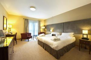 A bed or beds in a room at Bicester Hotel, Golf & Spa