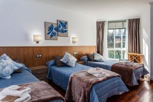 Cama o camas de una habitación en O Castelo
