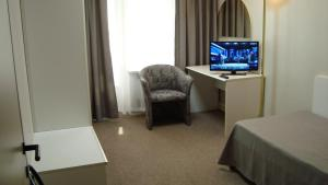 A television and/or entertainment center at Hotel Venice