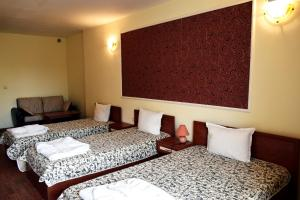 A bed or beds in a room at Ryor Hotel