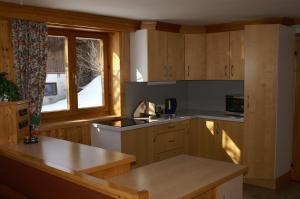 Kuchyň nebo kuchyňský kout v ubytování Klausnerhof