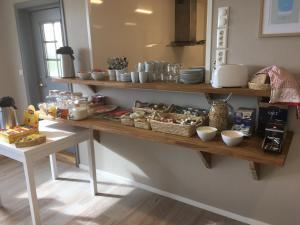 A kitchen or kitchenette at Lofoten Bed & Breakfast Reine - Rooms & Apartments