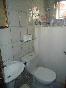 Um banheiro em Pousada Recanto das Tartarugas