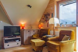 Telewizja i/lub zestaw kina domowego w obiekcie Apartament KROKUS