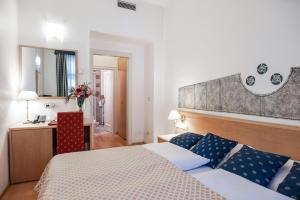 Letto o letti in una camera di Hotel Tivoli Prague