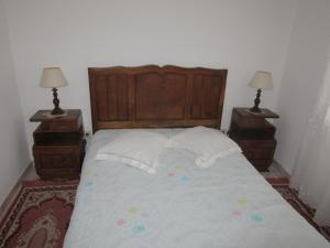 A bed or beds in a room at Eira do Povo 1