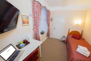 A television and/or entertainment center at Gatwick Turret Guest House