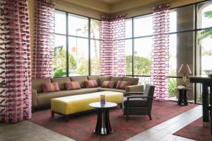 A seating area at Ramada by Wyndham Orlando Florida Mall