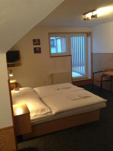 A bed or beds in a room at Penzion Globus