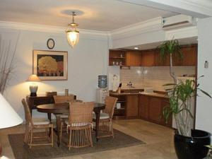 A kitchen or kitchenette at Jayakarta Resort Apartments