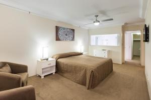 A bed or beds in a room at Belle Maison Apartments - Official