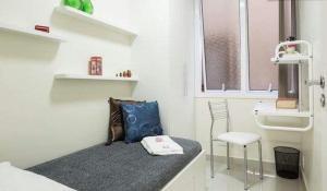 A bathroom at Apto 5 Quartos Avenida Carlos Gomes