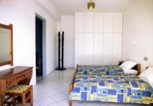 A bed or beds in a room at Eleni Palace