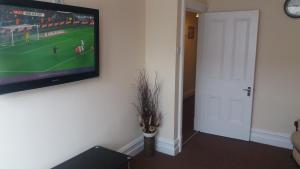 A television and/or entertainment centre at Delamere holiday flat