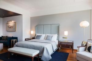A bed or beds in a room at The Oberoi New Delhi