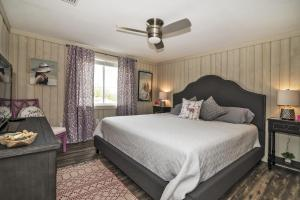 A bed or beds in a room at Serenity By The Sea Cottage A