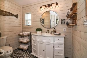 A bathroom at Serenity By The Sea Cottage A