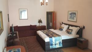 A bed or beds in a room at Penzion PIANO & Apartment PIANO