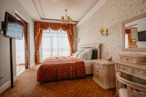 A bed or beds in a room at Imperial Club Deluxe