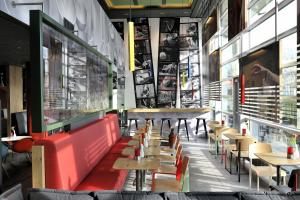 A restaurant or other place to eat at ibis Amsterdam City West