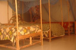 Ein Etagenbett oder Etagenbetten in einem Zimmer der Unterkunft Ker Jahkarlo