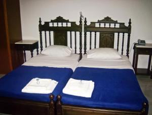 Ένα ή περισσότερα κρεβάτια σε δωμάτιο στο Κατσαράκη Φωτεινή