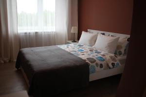 A bed or beds in a room at Bonbonche Apartaments
