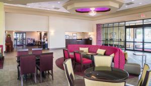The lounge or bar area at Ramada by Wyndham Orlando Florida Mall