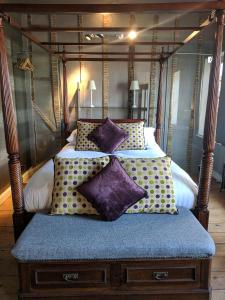 A bed or beds in a room at The Wellington