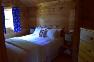 A bed or beds in a room at The Markland