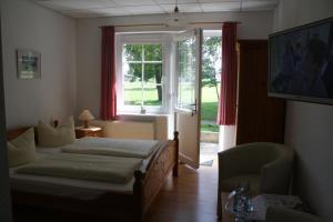 Ein Bett oder Betten in einem Zimmer der Unterkunft Pension Treenehof