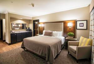 A bed or beds in a room at Best Western Premier Helena Great Northern Hotel