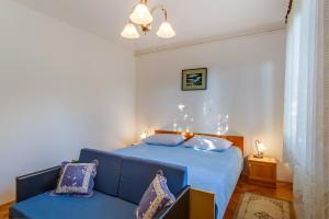 A bed or beds in a room at Apartments Beba