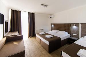 A bed or beds in a room at Despina Family Hotel