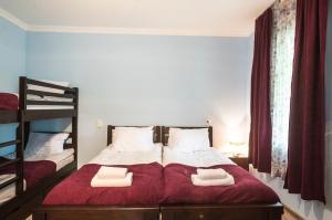 Кровать или кровати в номере Lutrezi