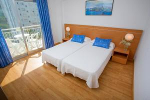 A bed or beds in a room at Gandia Playa