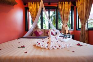 A bed or beds in a room at Golden Butterfly Villa
