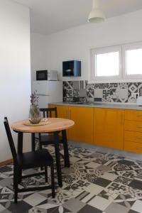 A cozinha ou kitchenette de Carmo Terrace Apartment