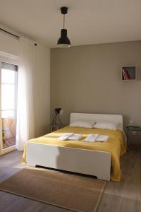 Uma cama ou camas num quarto em Carmo Terrace Apartment