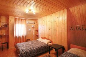 Кровать или кровати в номере Ogni Stolitsy
