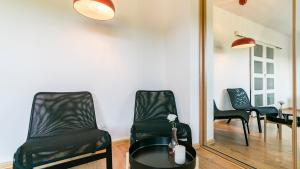 A seating area at Gdansk Apartments4rent Airport