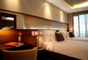A bed or beds in a room at ShaSa Resort & Residences, Koh Samui