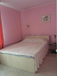 Кровать или кровати в номере Appartamenty 2