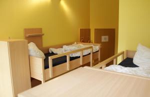 Ein Bett oder Betten in einem Zimmer der Unterkunft Jugendherberge Rudi Arndt