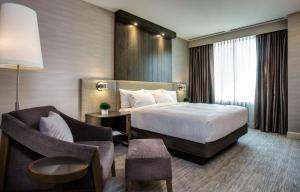 A bed or beds in a room at Hyatt Centric Chicago Magnificent Mile