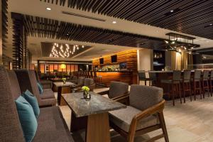 The lounge or bar area at Hyatt Centric Chicago Magnificent Mile