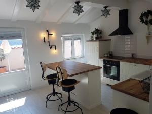 A kitchen or kitchenette at SKIP Apartment