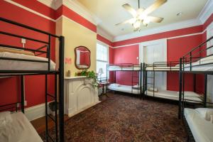 A bunk bed or bunk beds in a room at Auberge NOLA Hostel