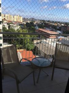 A balcony or terrace at Vista Panorâmica com piscina