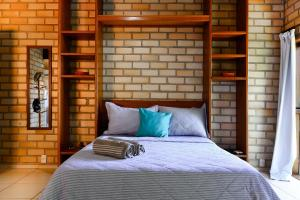 A bed or beds in a room at Adora Suites